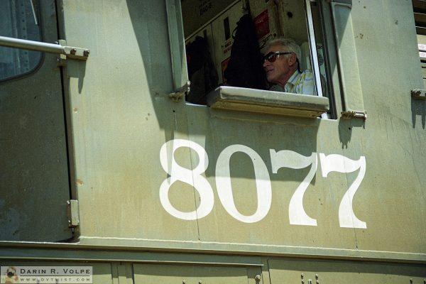 """8077"" [Railroad Conductor in a GE B40-8 in San Luis Obispo, California]"