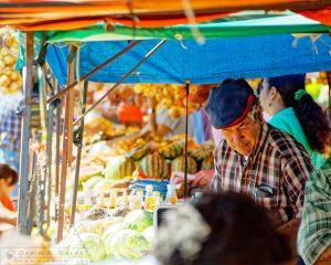 """""""Feria del Agricultor"""" [Vendor at a Farmers' Market in San Jose, Costa Rica]"""