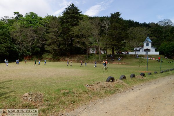Soccer game and church in Caragral, Costa Rica.