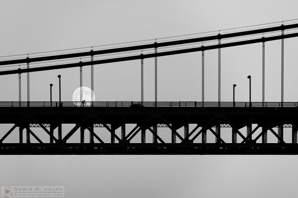 """Moonlight Ride"" [Bicyclist on the Golden Gate Bridge in San Francisco, California]"