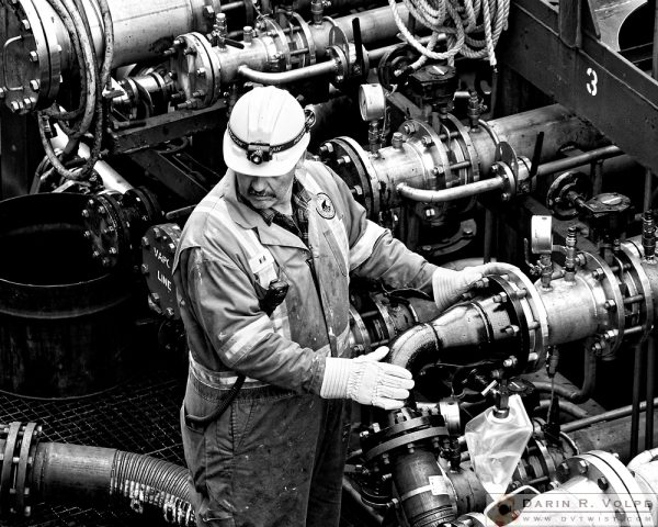 """Fill 'er Up"" [Workman Aboard a Fuel Tanker in Halifax, Nova Scotia]"