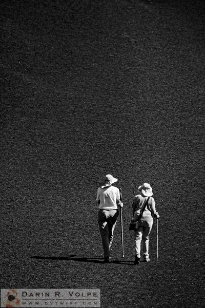 """Moonwalk"" [Hikers on Inferno Cone in Craters of the Moon National Monument, Idaho]"