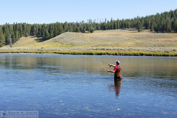 """Ahhhh, West and Weewaxation at Wast!"" [Fisherman in Yellowstone National Park, Wyoming]"