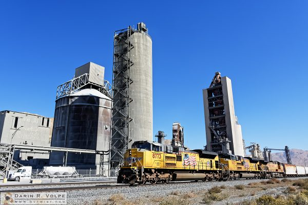 """""""Building America"""" [Union Pacific Freight Train and Cement Plant in Monolith, California]"""
