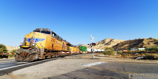 """Sign of the Times"" [Union Pacific Freight Train at a Grade Crossing in Caliente, California]"