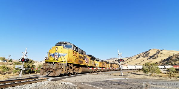 """Rounding the Horseshoe"" [Union Pacific Freight Train in Caliente, California]"