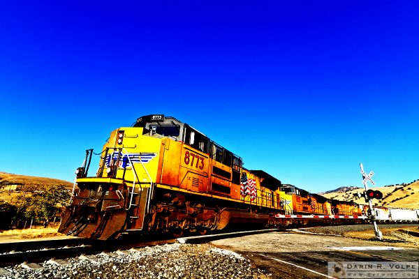 """Bells and Whistles"" [Union Pacific Freight Train at Railroad Crossing in Caliente, California]"
