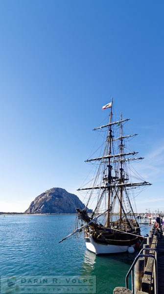 """Every Lady Loves a Big Rock"" [Sailing Ship Lady Washington and Morro Rock in Morro Bay, California]"